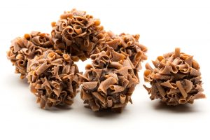 creamy baileys ganache dipped in milk chocolate and rolled in caramel curls