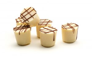 zesty lemon truffle in a white chocolate cup