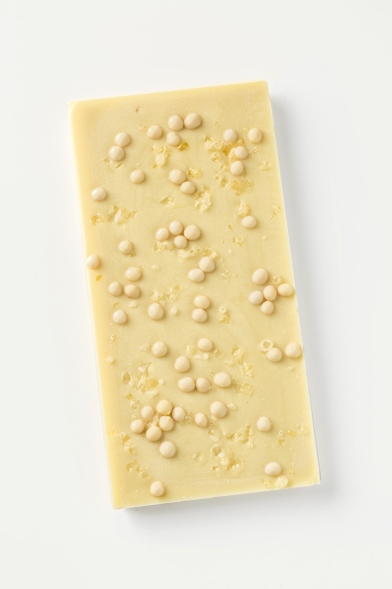 white chocolate bar with popping candy and crunchy pieces