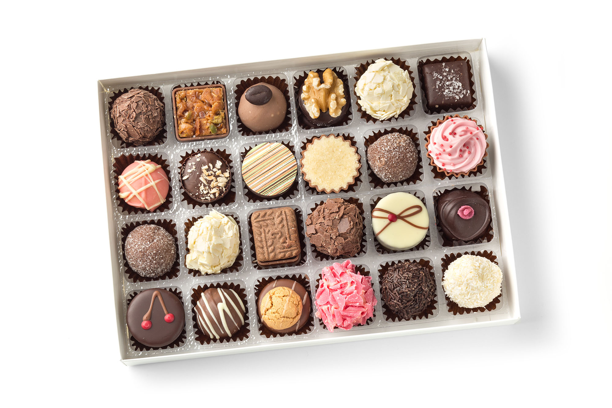 a selection of chocolates, pralines and crreams