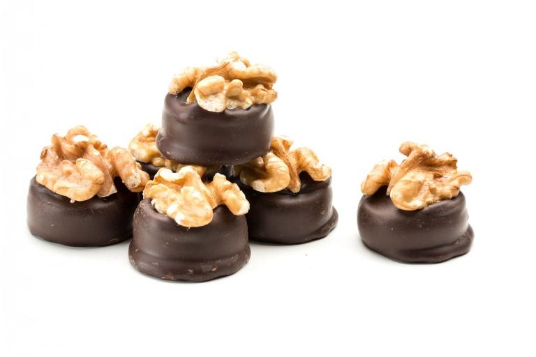 dark chocolate walnut creams topped with a whole walnut
