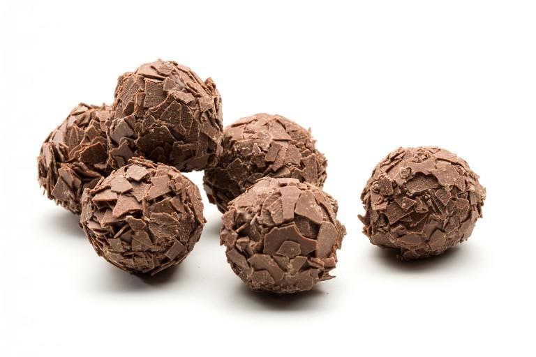creamy ganach hand dipped in milk chocolate and rolled in milk chocolate flakes