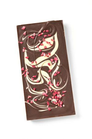 dark chocolate bar with a white chocolate swirl and raspberry crumbs
