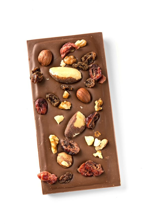 milk chocolate topped with fruit and nut