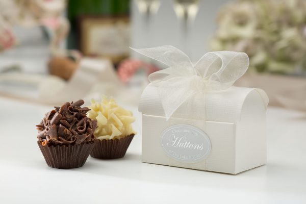 two choclates in a white chest box and white organza